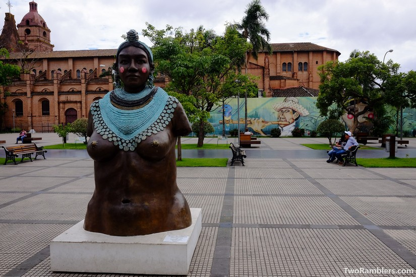 Statue of a Guarani woman with turquoise jewlery