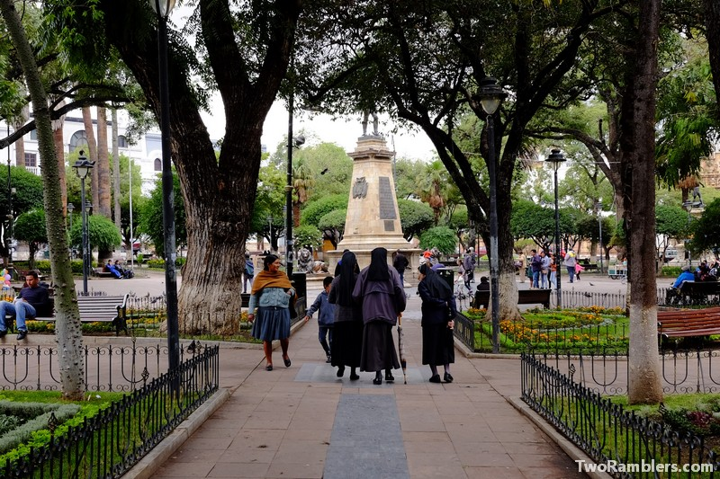 City square, nuns meeting lady in traditional Bolivian clothes
