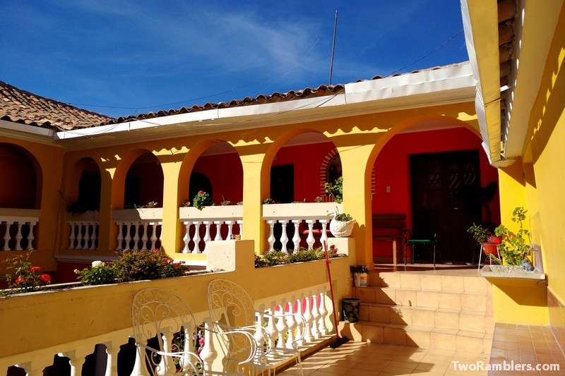 Terrace of a yellow building in the sun