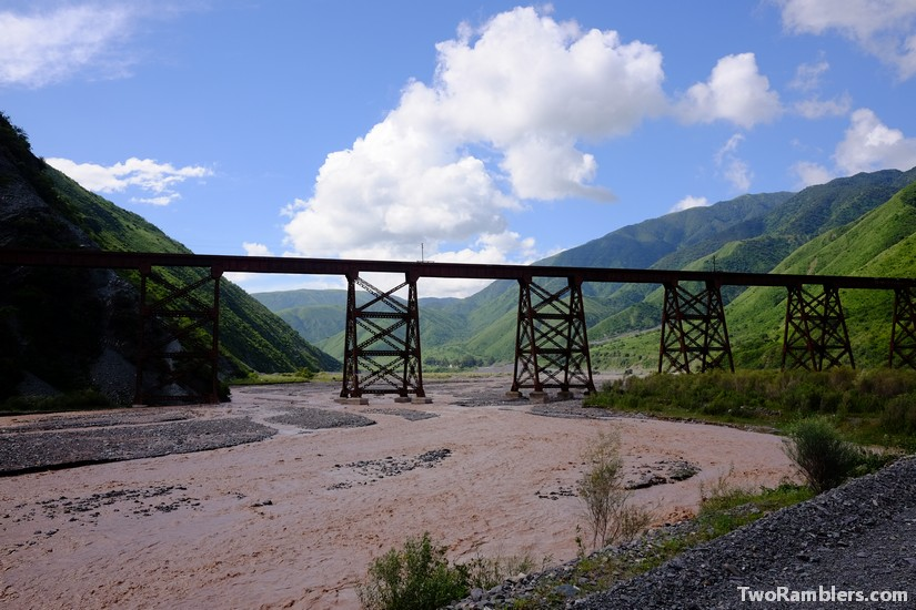 Steel train bridge over a river