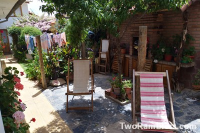 Backyard with deck chairs in the sun