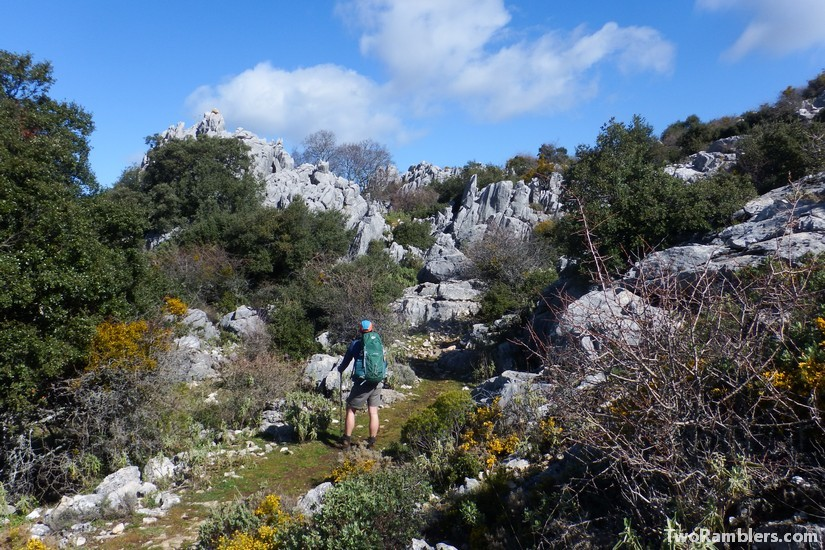Hiker on a trail between rocks, Andalucía