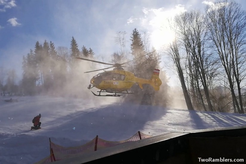Helicopter landing on ski slope