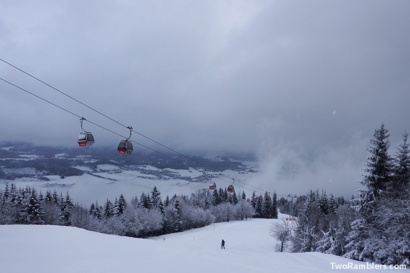 Empty skiing slope and low hanging clouds