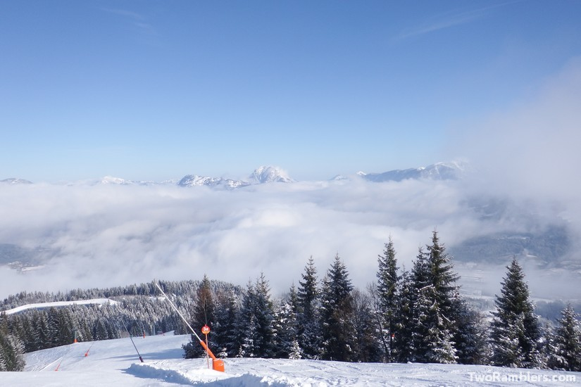 Empty skiing slope above the clouds