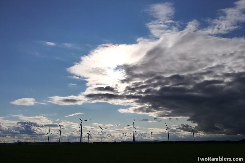 threatening clouds over windmills
